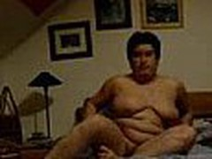 Well here's one more chubby mature mom taping herself during a masturbation session in this video clip. She fingers her pussy with as many fingers as she needs while showing off her enormous saggy tits